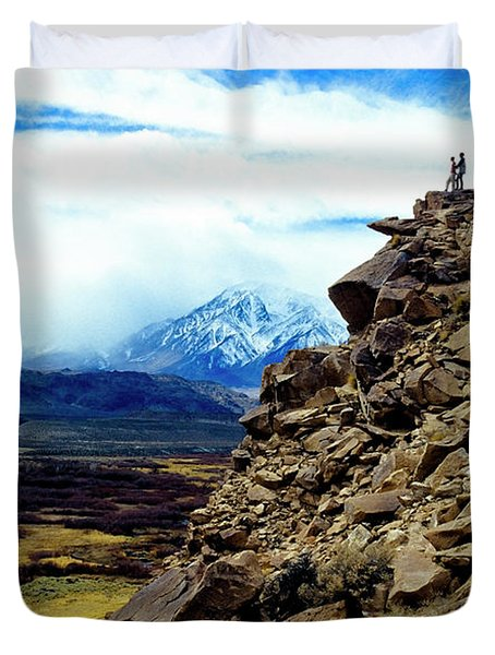 A Couple Stands On Top Of A Lava Butte Duvet Cover