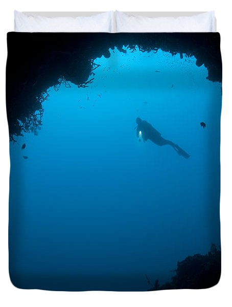 A Diver Explores A Cavern In Gorontalo Duvet Cover by Steve Jones