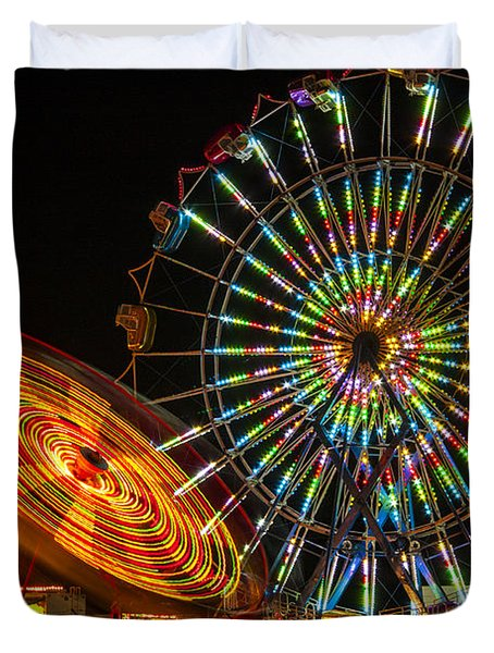 Duvet Cover featuring the photograph Colorful Carnival Ferris Wheel Ride At Night by Jerry Cowart