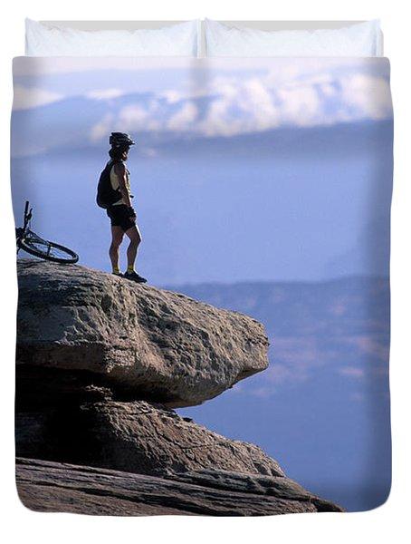 A Female Mountain Biker Stands Duvet Cover