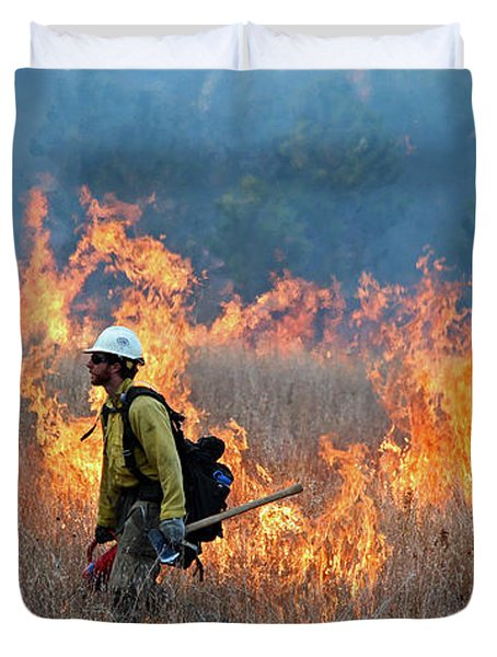 A Firefighter Ignites The Norbeck Prescribed Fire. Duvet Cover