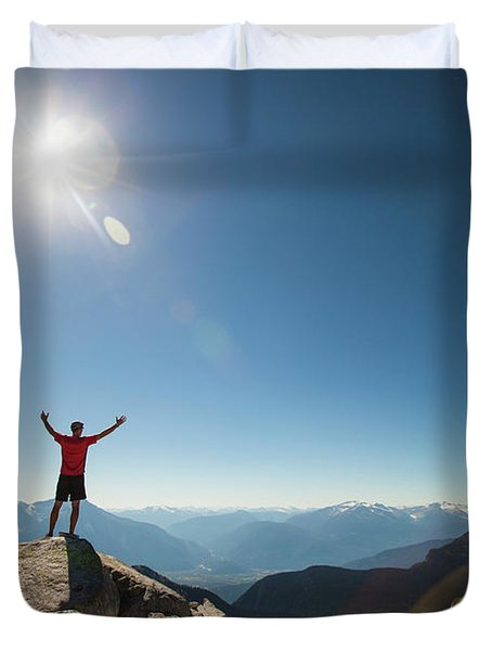 A Hiker Celebrates After Reaching Duvet Cover