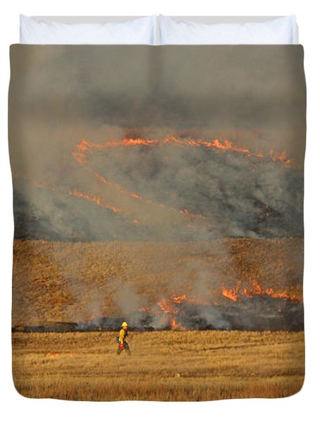 A Lone Firefighter On The Norbeck Prescribed Fire. Duvet Cover