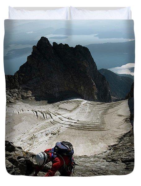 A Male Climber Climbs Mt. Moran Duvet Cover