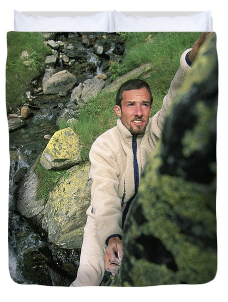 A Man Bouldering In Switzerland Duvet Cover