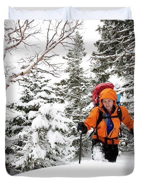 A Man Hiking Through The Snow On Mt Duvet Cover