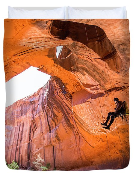 A Man Rapelling While Canyoneering Duvet Cover