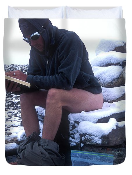A Man Reads While Using A Snow-covered Duvet Cover