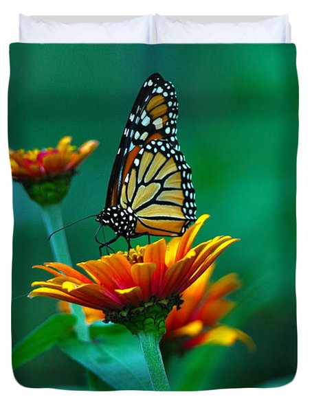 Duvet Cover featuring the photograph A Monarch by Raymond Salani III