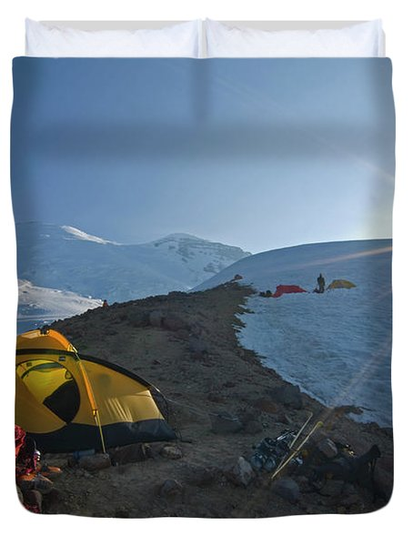 A Mountaineer Contemplates The Sun Duvet Cover