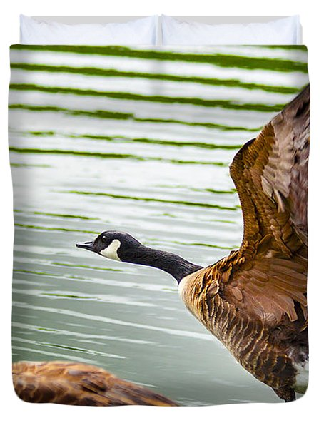 A Pair Of Canada Geese Landing On Rockland Lake Duvet Cover by Jerry Cowart