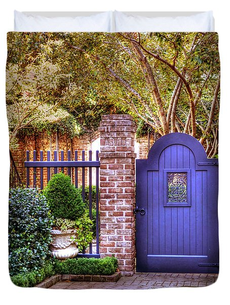 Duvet Cover featuring the photograph A Private Garden In Charleston by Kathy Baccari