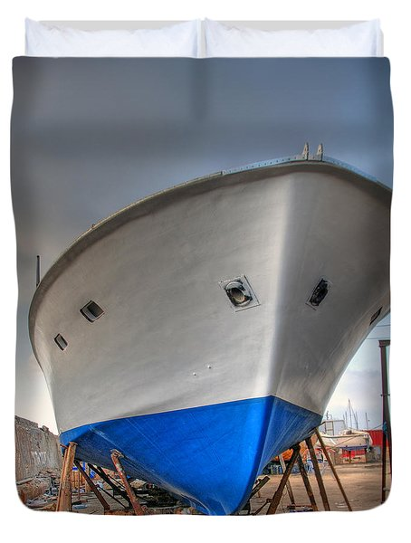 Duvet Cover featuring the photograph a resting boat in Jaffa port by Ron Shoshani