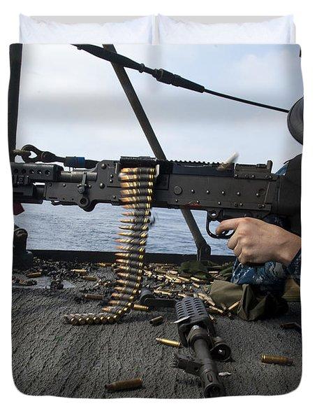 A Sailor Fires An M-240b Machine Gun Duvet Cover by Stocktrek Images