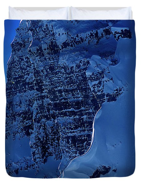 A Skier Drops From Snowy Cliff Duvet Cover