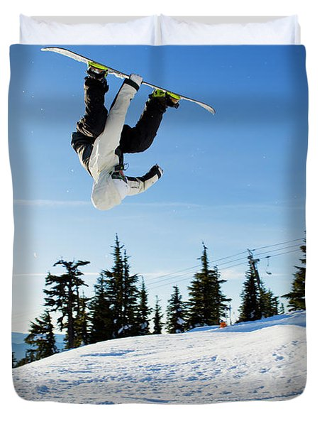 A Snowboarder Does A High Flying Ariel Duvet Cover