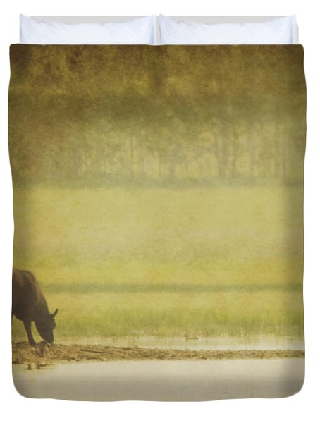 A Steer At A Pond Having A Drink In Red Duvet Cover by Roberta Murray