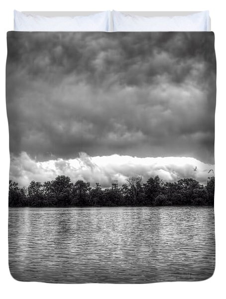 A Storm Rolls By Duvet Cover by Thomas Young