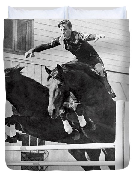 A Stunt Rider On Two Horses. Duvet Cover