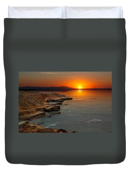 A Sunset Duvet Cover by Lynn Geoffroy