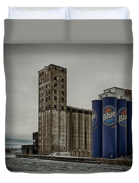 A Tall Blue Six-pack Duvet Cover by Guy Whiteley