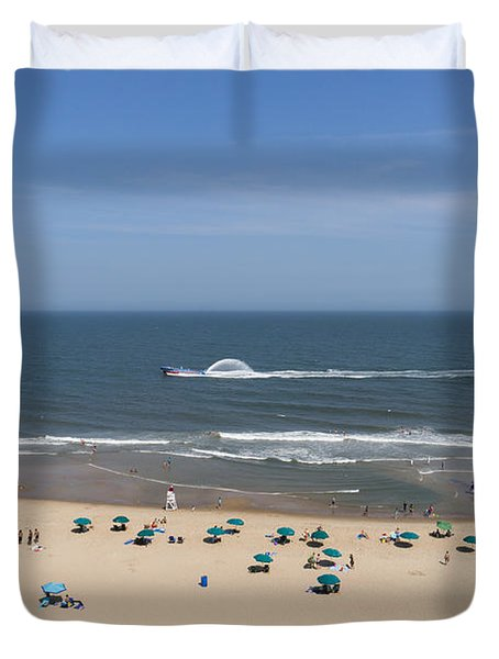 A Touring Speedboat Passes By Shore In Ocean City Maryland Duvet Cover