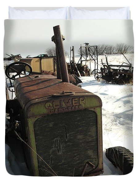 A Tractor In The Snow Duvet Cover by Jeff Swan