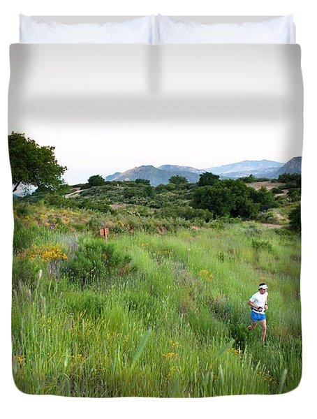 A Trail Runner Crosses Through Green Duvet Cover