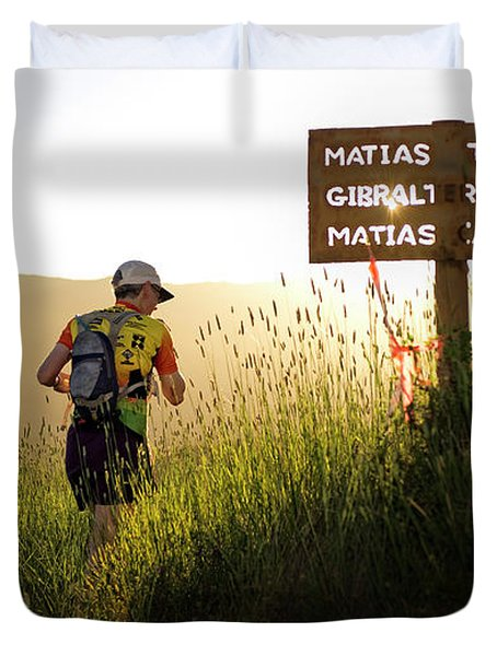 A Trail Runner Passes A Sign And Trail Duvet Cover