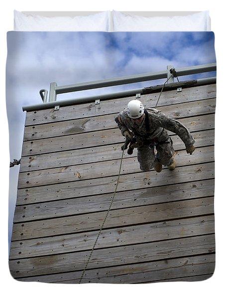 A U.s. Soldier Runs Down A 40-foot Duvet Cover by Stocktrek Images