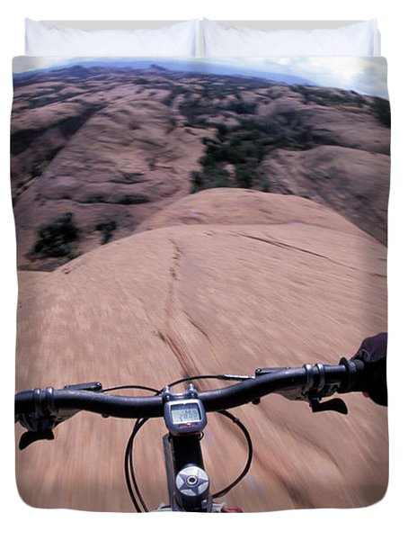 A View Of A Female Mountain Bikers Duvet Cover