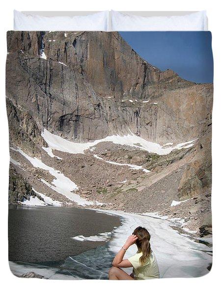 A Woman Looks Across A Partially Frozen Duvet Cover