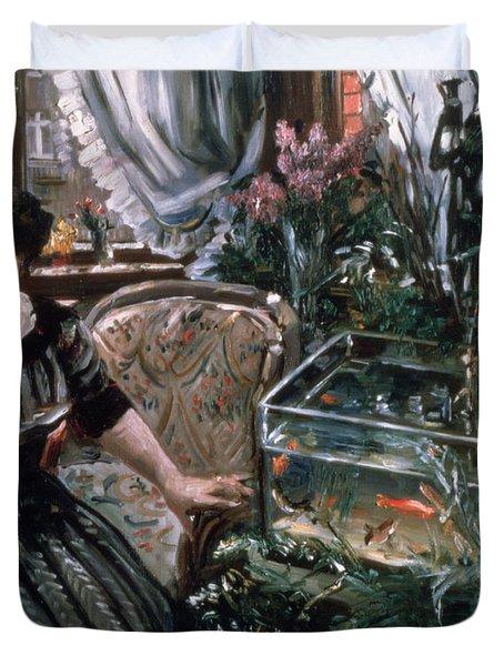 A Woman Reading Near A Goldfish Tank Duvet Cover