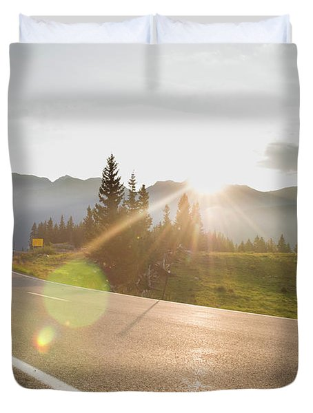 A Woman Road Biking On Highway 550 Duvet Cover