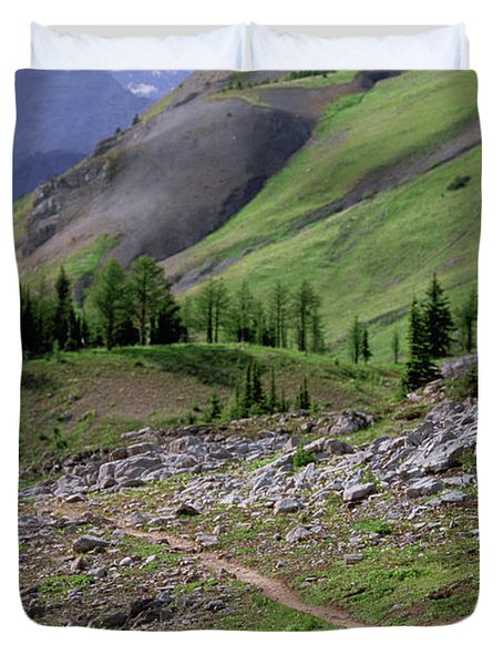 A Woman Trail Running In The Canadian Duvet Cover