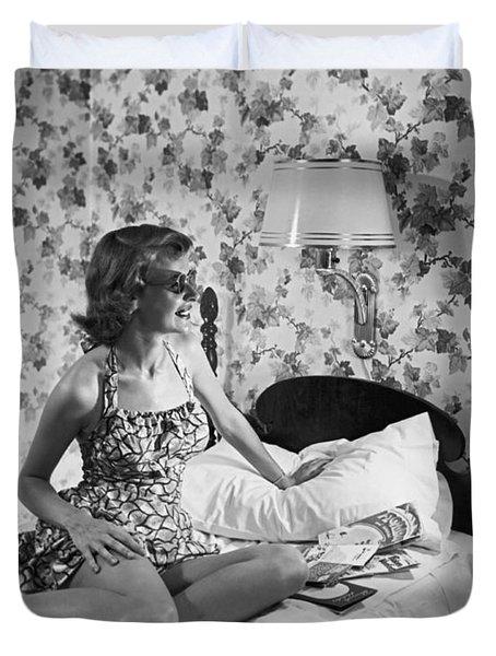 A Woman Using A Sun Tan Lamp Duvet Cover