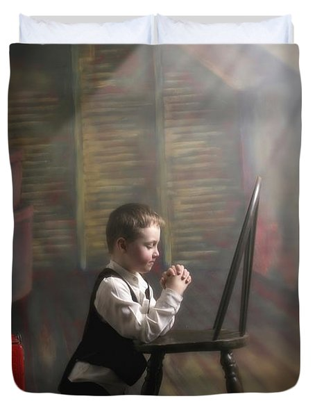 A Young Boy Praying With A Light Beam Duvet Cover by Pete Stec