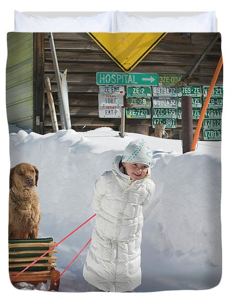 A Young Girl Hauls Her Dog In A Sled Duvet Cover