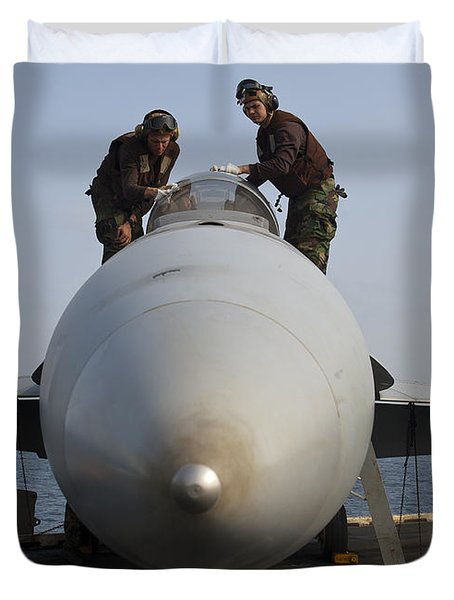 Airmen Clean The Canopy Of An Fa-18f Duvet Cover by Stocktrek Images