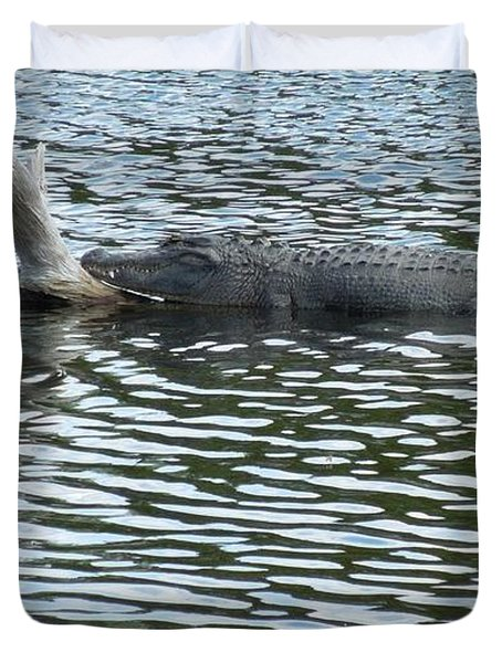 Duvet Cover featuring the photograph Alligator Resting On A Log by Ron Davidson