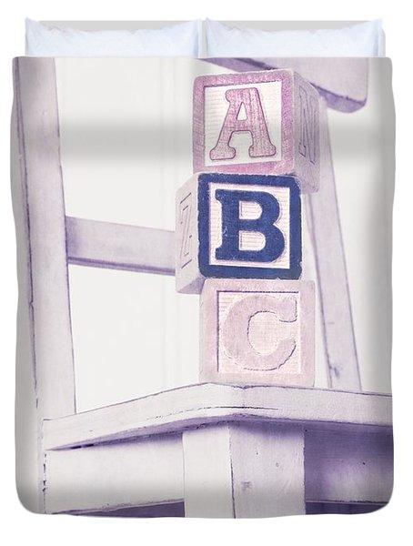 Alphabet Blocks Chair Duvet Cover by Edward Fielding