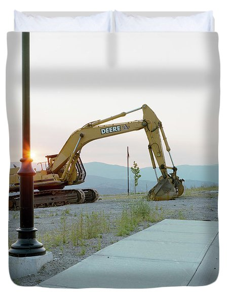 An Excavator Sits Idle On An Duvet Cover
