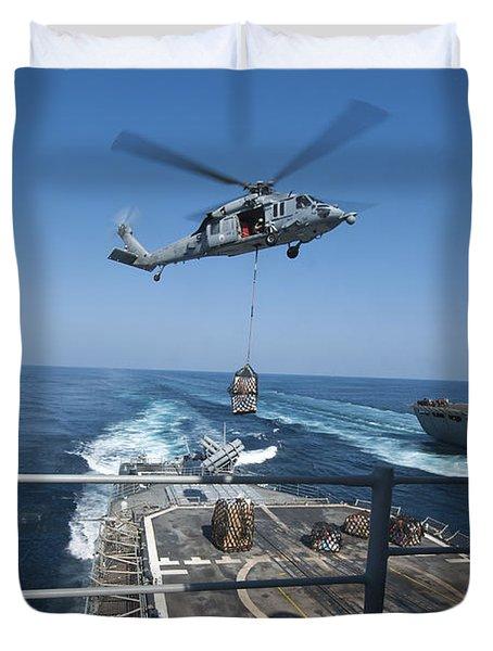 An Mh-60s Sea Hawk Brings Pallets Duvet Cover by Stocktrek Images