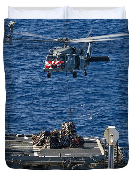 An Mh-60s Sea Hawk Delivers Supplies Duvet Cover by Stocktrek Images