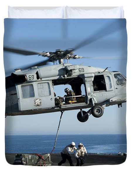 An Mh-60s Sea Hawk Helicopter Prepares Duvet Cover by Stocktrek Images