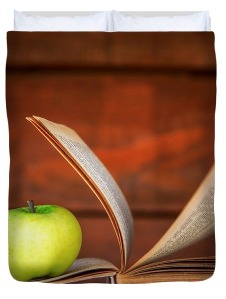 Apple And Book Duvet Cover by Michal Bednarek
