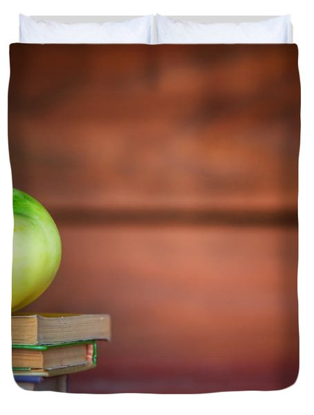 Apple On Pile Of Books Duvet Cover by Michal Bednarek