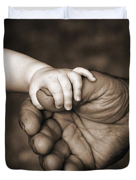 Babys Hand Holding On To Adult Hand Duvet Cover by Corey Hochachka