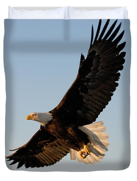 Bald Eagle Flying With Fish In Its Talons Duvet Cover by Stephen J Krasemann