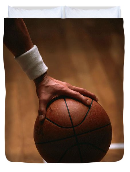 Basketball Ball In Male Hands Duvet Cover by Lanjee Chee